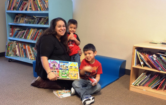 Carmen Campos with her sons Christian 4 and Alexander 2, in Bryan's House library.